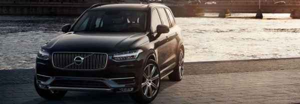 black volvo xc90 waterfront